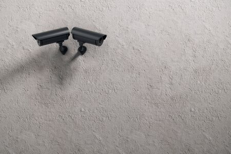 private security: Two black CCTV cameras on concrete wall background with copyspace. Robbery concept. 3D Rendering