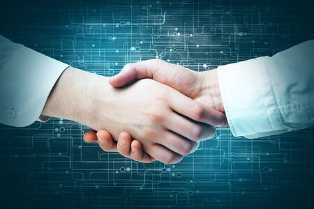 digital background: Side view and close up of handshake on abstract circuit background. Teamwork concept