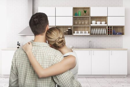 Back view of young european couple looking at modern kitchen interior. Family concept. 3D Rendering