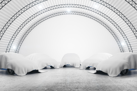 Abstract warehouse interior with cars under white cloths. Presentation concept. 3D Rendering