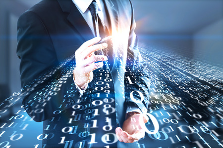 technology background: Unrecognizable businessman drawing abstract binary code stream on blurry interior background. Programming concept. Double exposure