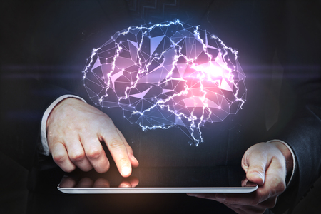 technology background: Hands holding tablet with abstract polygonal brain hologram. Artificial intelligence and technology concept. 3D Rendering