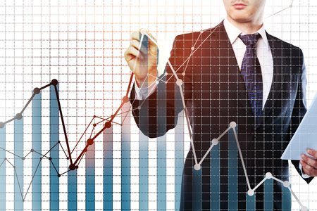 Businessman drawing digital business chart on white grid background. Finance concept. Double exposure