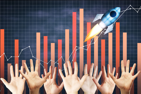 technology background: Waving hands on abstract chalkboard background with business sketch and launching rocket. Teamwork and startup concept Stock Photo