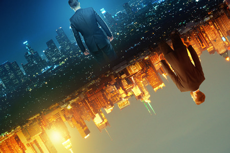 Businessmen on abstract glowing split world city background. Imagination concept