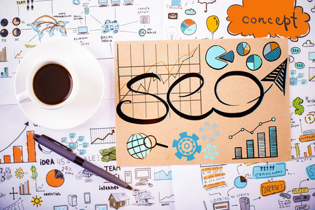 technology background: Top view of office workplace with coffee cup, pen and business SEO sketch. Strategy concept Stock Photo