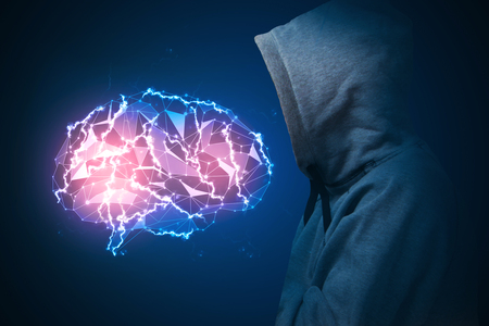 Side view of hipster male in hood looking at glowing polygonal brain on blue background. Artificial intelligence concept