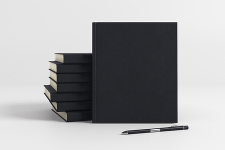 Stack of blank black hardcover organizers on light background. Supplies concept. Mock up, 3D Rendering Stock Photo