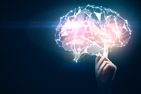 technology background: Hand pointing at digital glowing polygonal brain on dark blue background. Artificial intelligence and technology concept. 3D Rendering