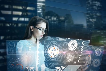 touchscreen: Attractive young european woman using laptop with abstract digital business interface. Future concept. Double exposure Stock Photo