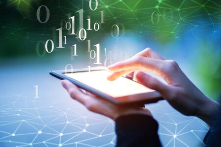 up code: Close up of hands using tablet with binary code on blurry background with polygonal mesh. Computing concept. Double exposure Stock Photo