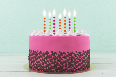 Beautiful birthday cake with candles on light background. Celebration concept. 3D Rendering Stock Photo