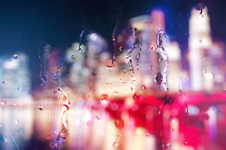 Abstract blurry night city background with rain drops on glass and text. Lifestyle concept. 3D Rendering Stock Photo