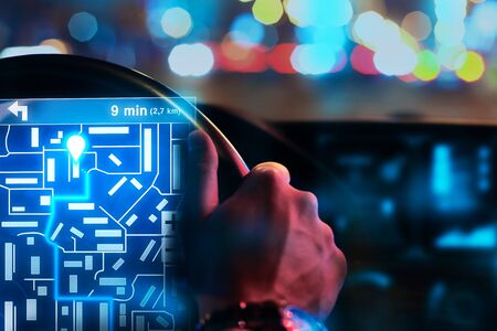 tracking: Close of male hands driving car with abstract digital hologram for tracking taxi car on map. Future and innovation concept. 3D Rendering