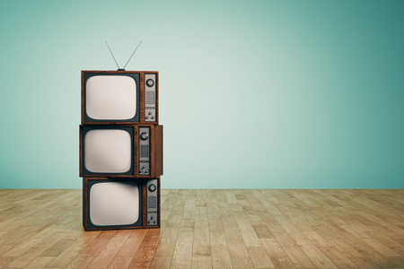 Pile of empty vintage TVs in interior with blue wall and wooden floor. Creativity concept. 3D Rendering  Stok Fotoğraf