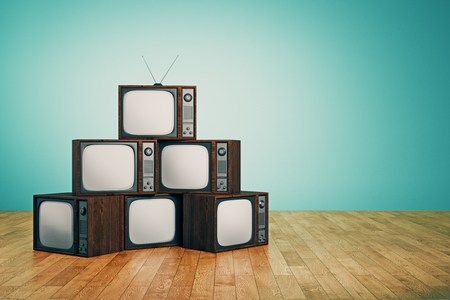 Pile of empty retro TVs in interior with blue wall and wooden floor. Creativity concept. 3D Rendering