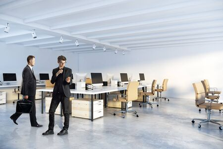 Young european businessmen standing in modern coworking office interior with. Workplace and lifestyle concept. 3D Rendering