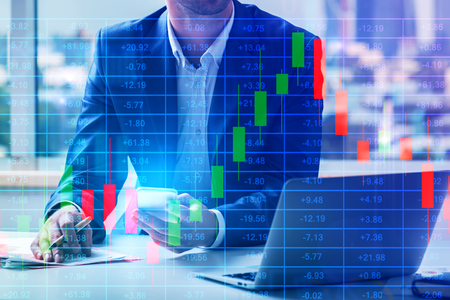 Businessman working on project at modern workplace with abstract forex chart. Toned image. Finance and accounting concept. Double exposure