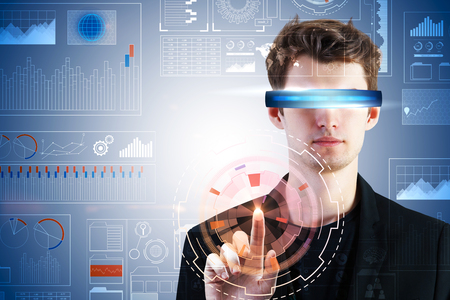 Portrait of handsome young european businessman with virtual reality glasses. Future and interface concept. Double exposure
