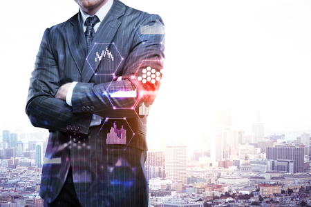 Businessman standing on abstract city background with business chart hologram. Future and success concept. Double exposure