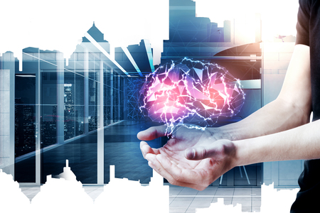 Male hands holding glowing polygonal brain on abstract city office background. Digital mind concept. Double exposure