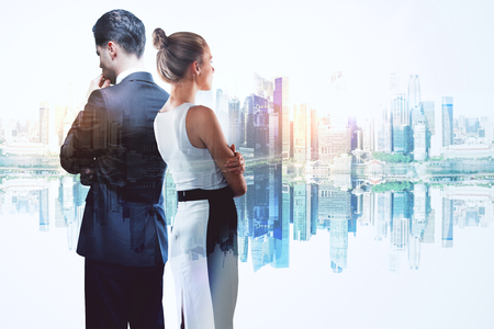 Businessman and woman on abstract reflected city background. Teamwork and success concept. Double exposure