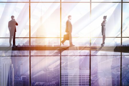 Businesspeople in abstract glass office interior with sunlight and city view. Meeting and group concept. Double exposure