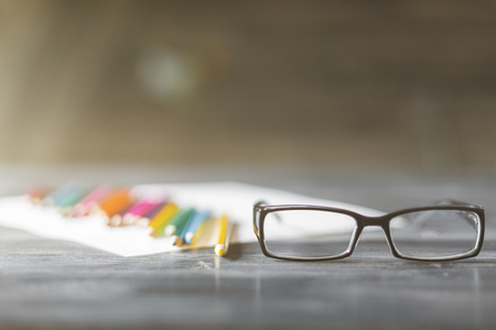 Close up of glasses and supplies on blurry background