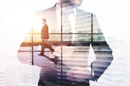 Success and financial growth concept. Businessman on abstract office city background with copy space. Double exposure
