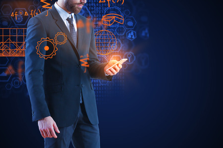 Businessman using smartphone with abstract glowing business hologram. Innovation and finance concept. Double exposure