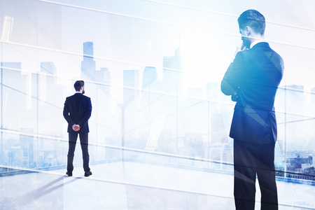 Success and executive concept. Businessman on abstract office city background with copy space. Double exposure