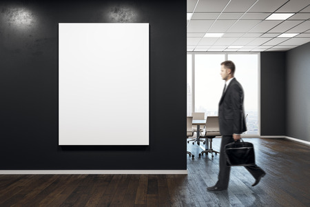 Businessman walking in modern conference room interior with empty poster. Mock up, 3D Rendering