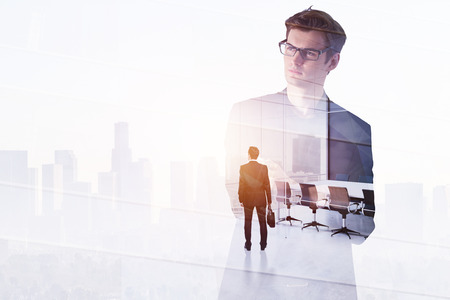 Businessman on abstract city office background. Success and workplace concept. Double exposure  Stock Photo