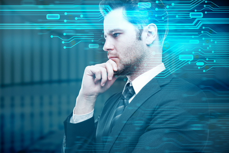 Side portrait of handsome thinking european businessman on blurry background with circuit board. Hardware and science concept. Double exposure  Stock Photo