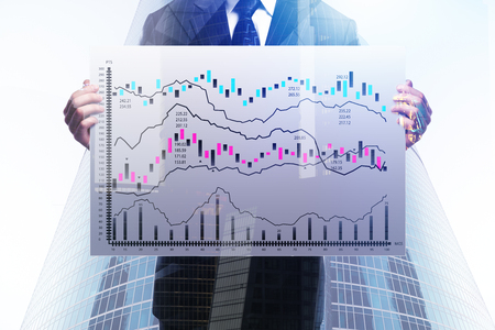 Success, presentation and finance concept. Businessman holding board with forex chart on abstract city background. Double exposure