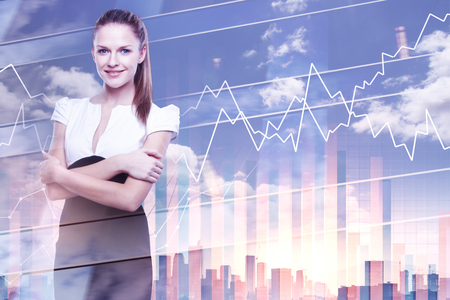 Portrait of attractive young european woman standing on bright city background with business chart. Employment and finance concept. Double exposure