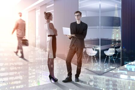 Meeting and teamwork concept. Businesspeople standing in abstract interior with sunlight. Double exposure  Standard-Bild