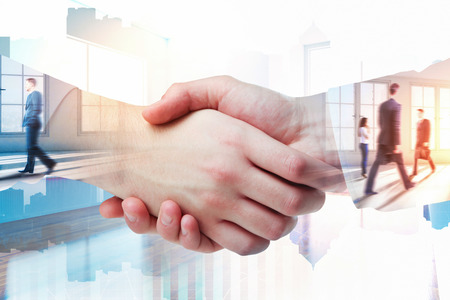 Handshake on abstract office city background. Teamwork and partnership concept. Double exposure  Standard-Bild