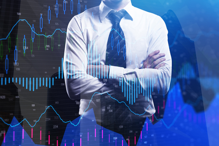 Businessman with folded arms standing on abstract forex chart city background. Fund management and broker concept. Double exposure
