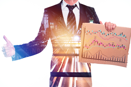 Success, presentation and income concept. Businessman holding board with forex chart on abstract city background. Double exposure