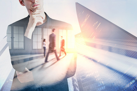 Meeting and research concept. Businesspeople standing in abstract interior with sunlight. Double exposure