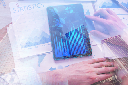 Hands using abstract tablet with forex chart on display. Accounting and device concept. Double exposure  Standard-Bild