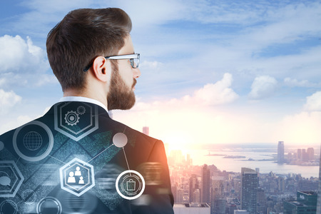 Investment and future concept. Thoughtful european businessman on abstract city background with business chart and daylight. Double exposure  Standard-Bild