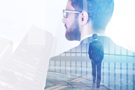 Success and employment concept. Businessman on abstract white office and city background with sunlight. Double exposure