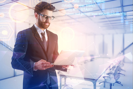 Businessman using laptop on abstract meeting room background with glowing digtal interface. Future and innovation concept. Double exposure  Standard-Bild