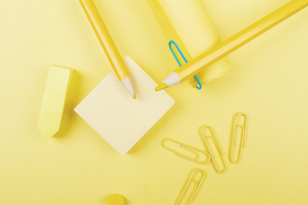 Creative yellow paper background with supplies. Copy space