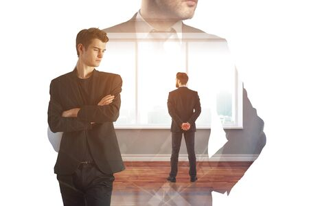 Businessmen standing in abstract office interior with city view. Success and employment concept. Double exposure  Stock Photo