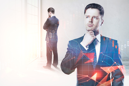 Thoughtful young businessman standing in blurry office interior with forex chart. Research, analysis and trade concept. Double exposure