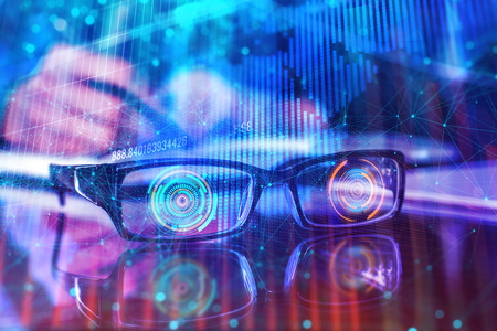 Close up of digital glasses on abstract background. Virtual reality concept. Double exposure  Фото со стока