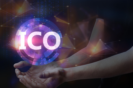 Hands holding blurry glowing ICO hologram on dark background. Initial coin offering concept. Double exposure